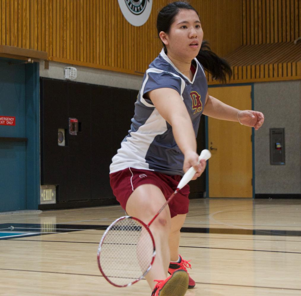De Anza College badminton player Tiffany Liao reaches low to strike the shuttlecock moments before it hits the ground at the badminton state championship at Mission College on Friday, May 12. Liao lost in the quarter final round.