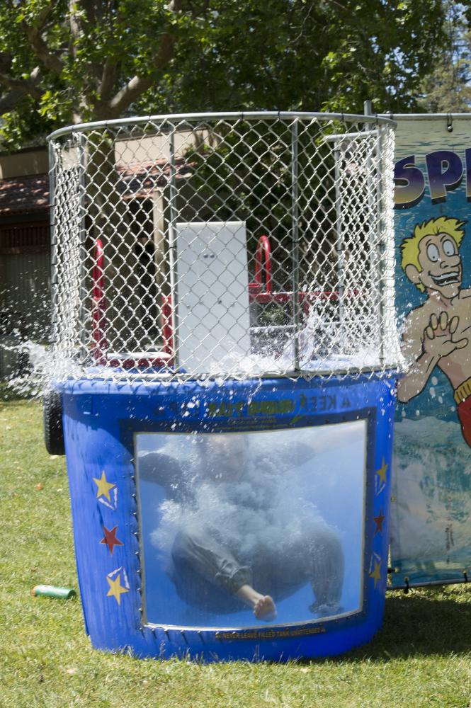 Kenzo Chua, 19, Film/TV major, falls into the Dunk Tank after a successful hit.