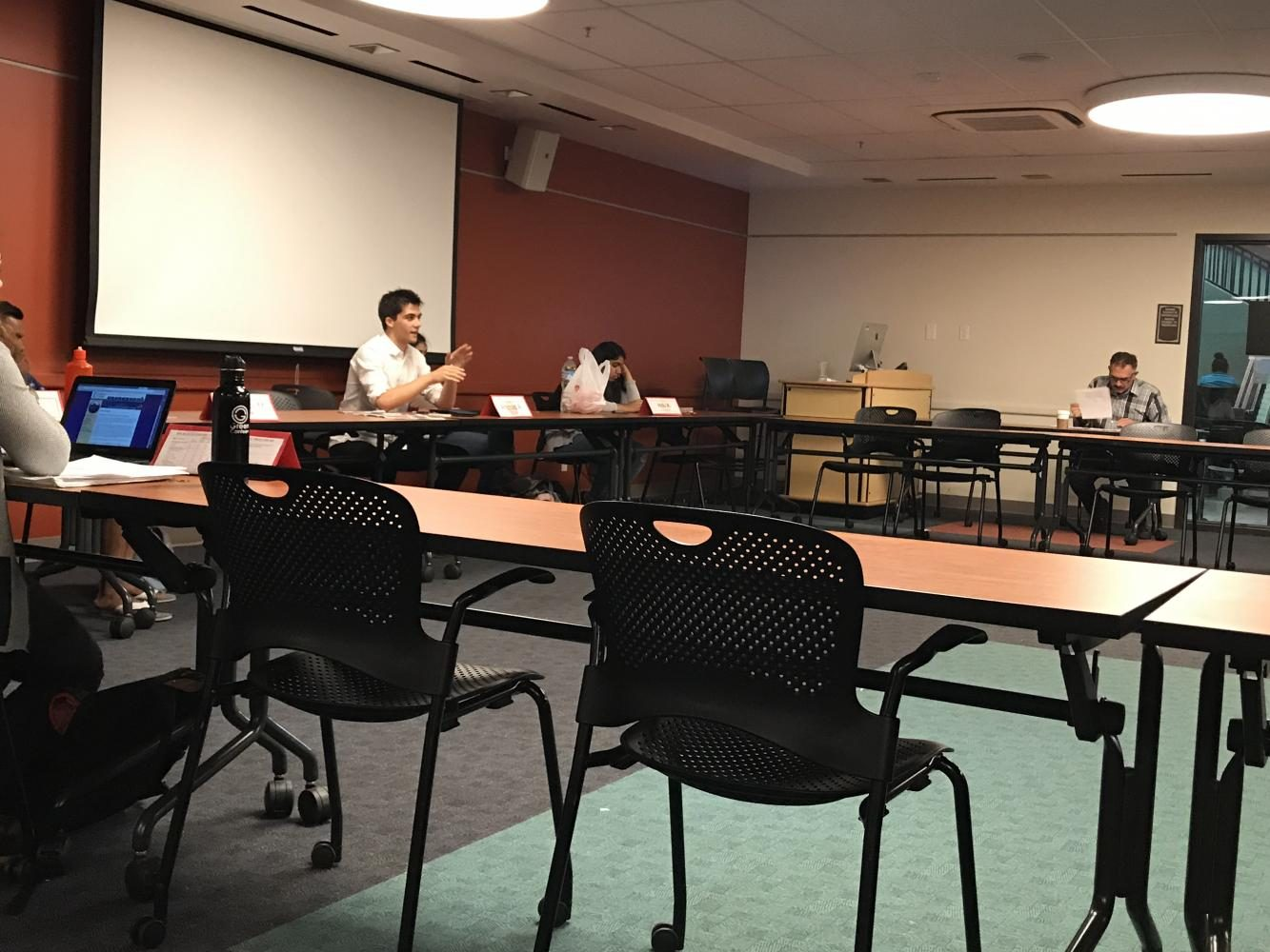 Senator Ali-Ahmad presents his research about food prices on campus at a DASB Senate meeting, and said that dining service staff said if prices do increase, it's to make it more affordable to hire more students.