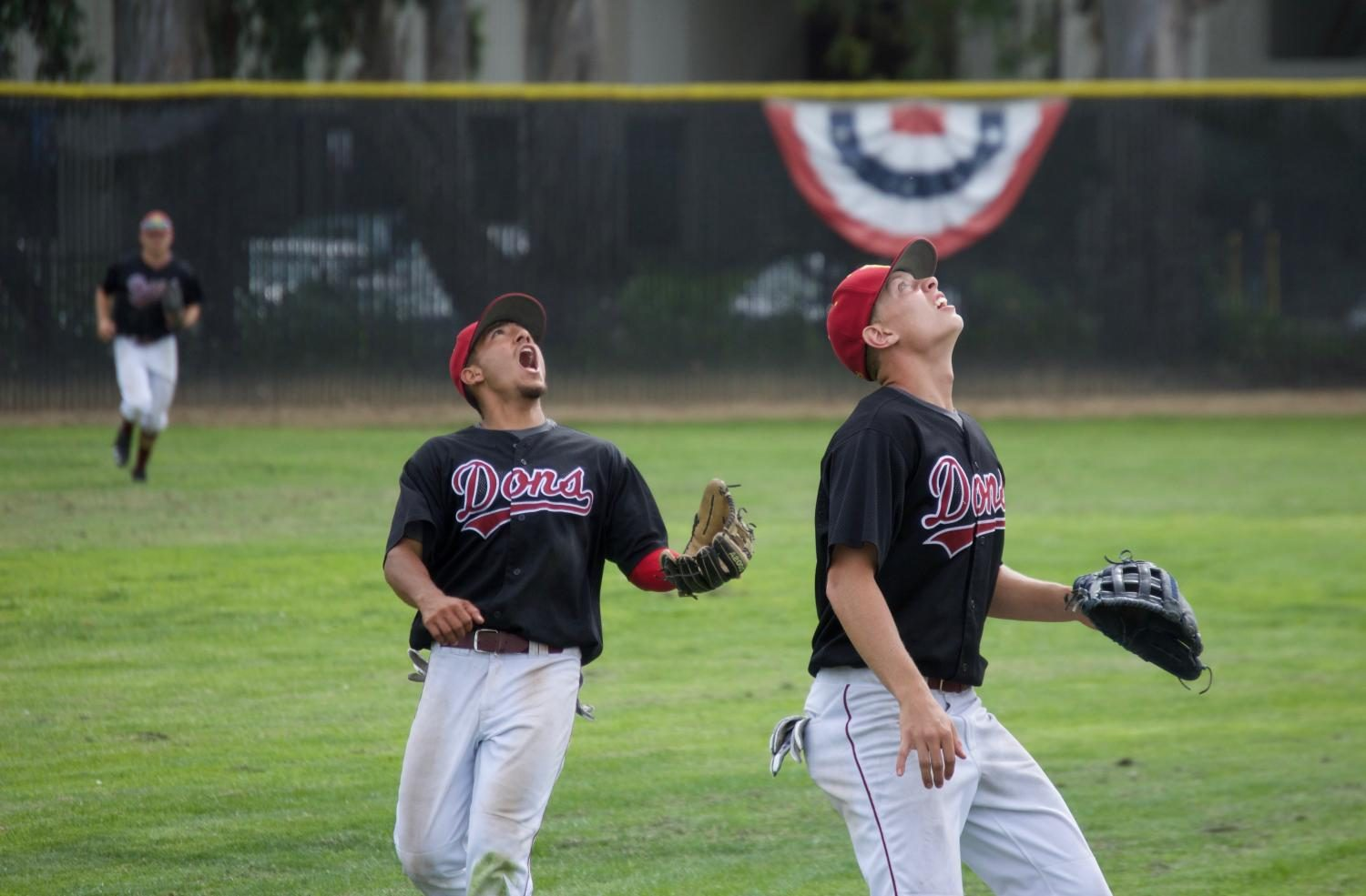 De Anza College third baseman Riki Desa calls off shortstop Chris Ramos before a inning ending flyout in a 7-2 loss to Cabrillo College on April 4, at Baylands Field.