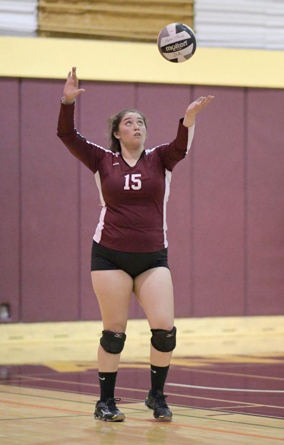 De Anza women's volleyball captain Kaitlyn Keller prepares to serve the ball.