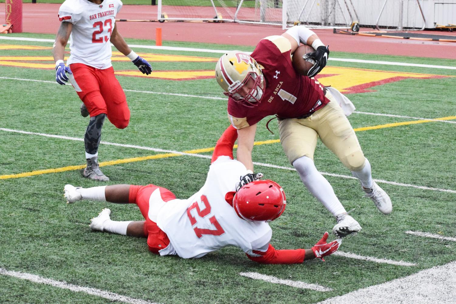 Paul Lomanto stiff-arms a San Francisco defender during a game on Nov. 4. The Dons lost, 58-0.