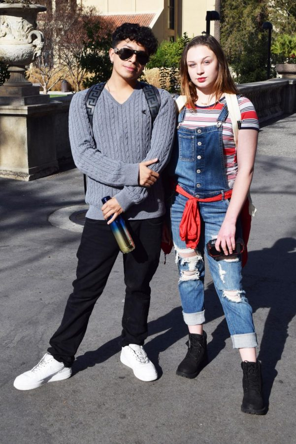 (from left) Erik Rocha, marketing major, wears a trendy gray sweater which makes a great outfit combining with his black jeans and white shoes, giving his look urban vibes.  His friend Jazmyne Burfine, psychology major, pairs blue denim ripped overalls with a red striped shirt. Her final touch for the look is red lipstick, a red scarf belt and black boots that give her look an industrial flair.