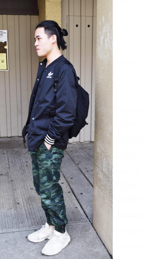 Alen Ho, business major, wears a sport-street look. His camouflage pants contrast with white shoes and black Adidas sport jacket. His final touch for the look is tied hair.