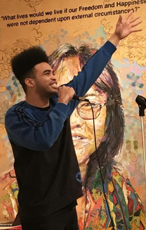 Tyrone Powell, known as MC Black Jesus, extends himself to the crowd at the Feb.1 First Thursday open mic in the Euphrat Museum.