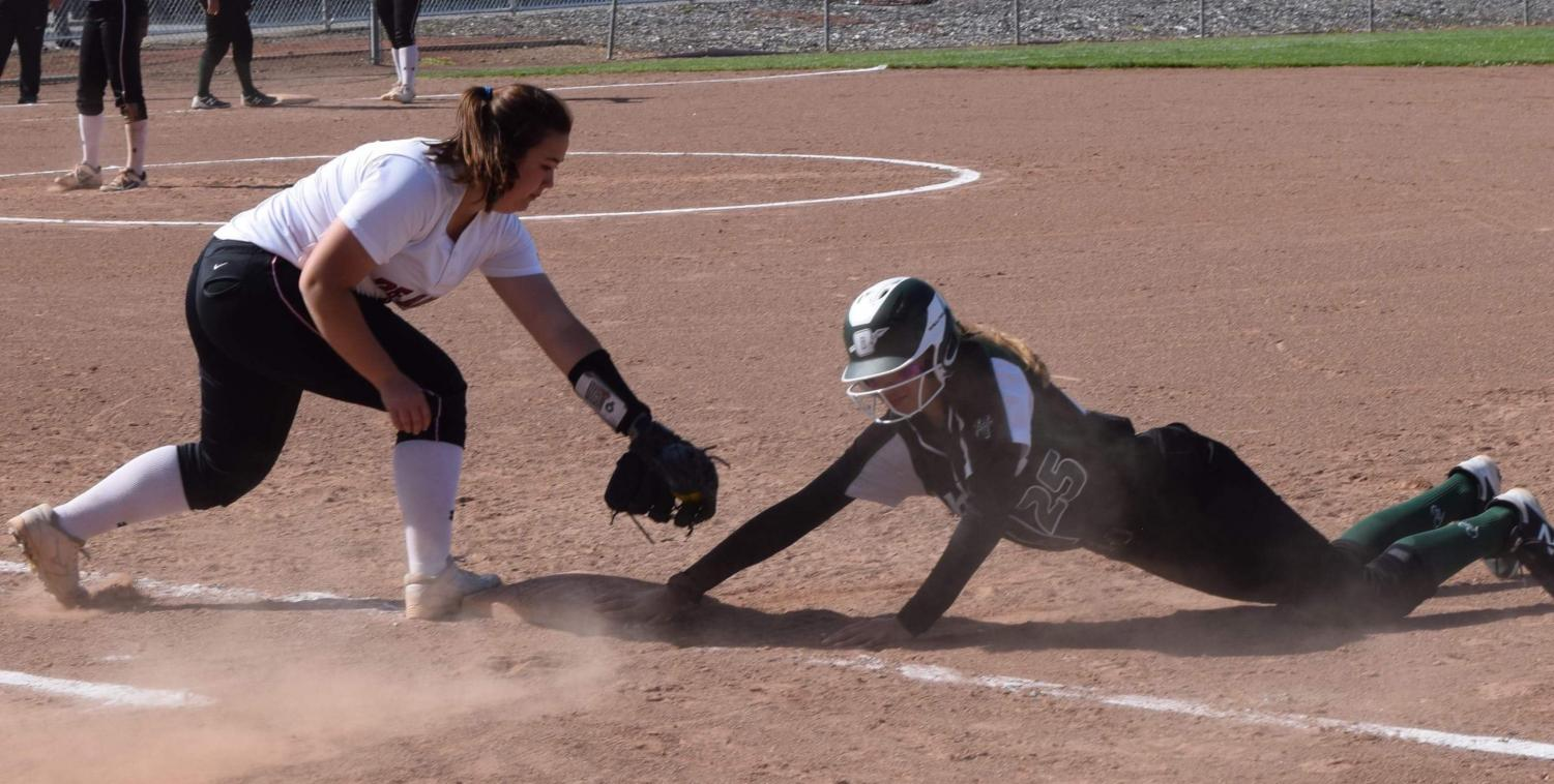 Dons infielder Jolyssa Ramirez attempts to tag out an Ohlone baserunner during their game at De Anza College on April 12