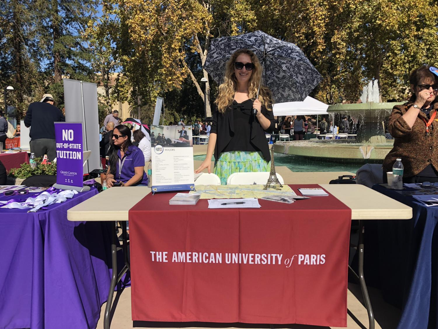 Jen Boucher, representative for The American University of Paris stands by the university's booth during Transfer Day.