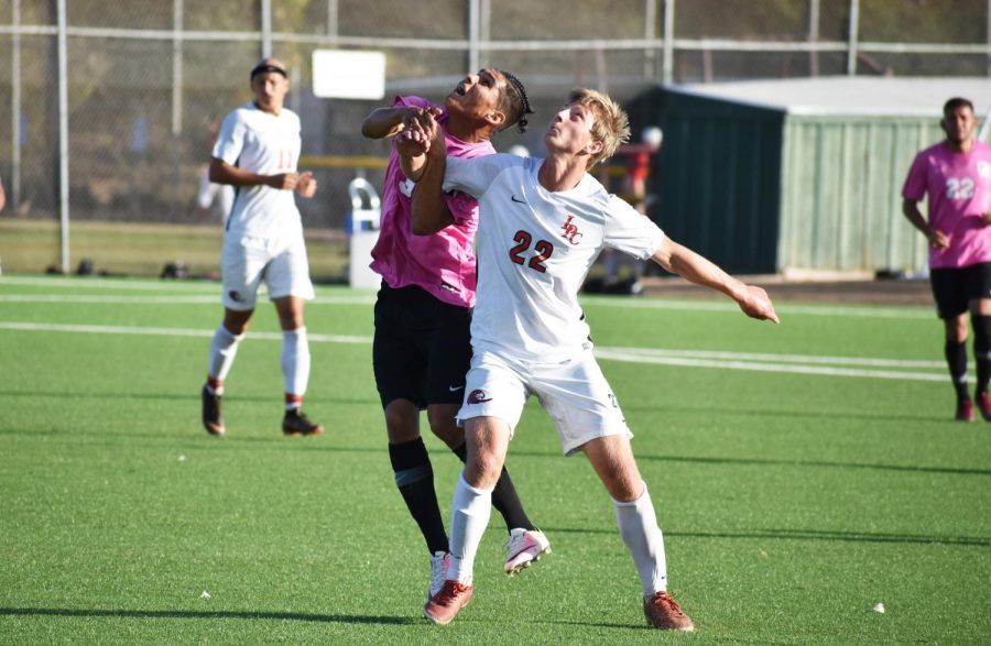 Alex Balleza, 21, kinesiology major, fighting for a header during a game on Tuesday, Oct. 30 against Las Positas at De Anza College.