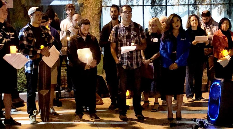 Students and community members sing and pray together at a vigil at San Jose State University on Monday, Oct. 29.