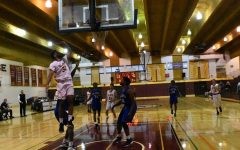 Men's basketball wins first home game against West Hills