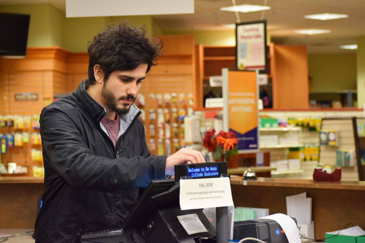 Brazilian student Vitor Miranda, 22, computer science major, works at the De Anza book-store textbook department.
