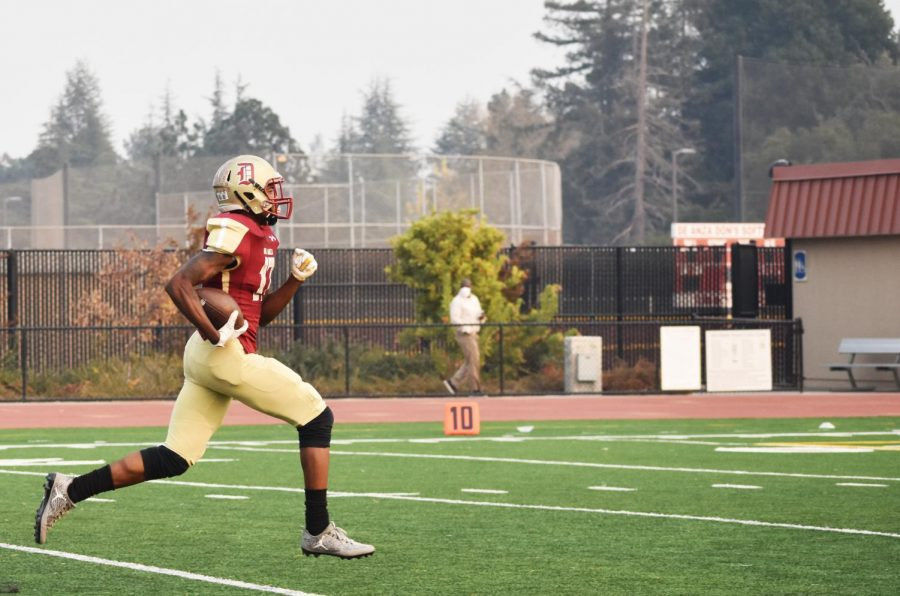Cortlandt Brooks, 19, engineering major, running for the touchdown during the game that took the team to the state championship on Nov. 10 at De Anza College against Yuba College.