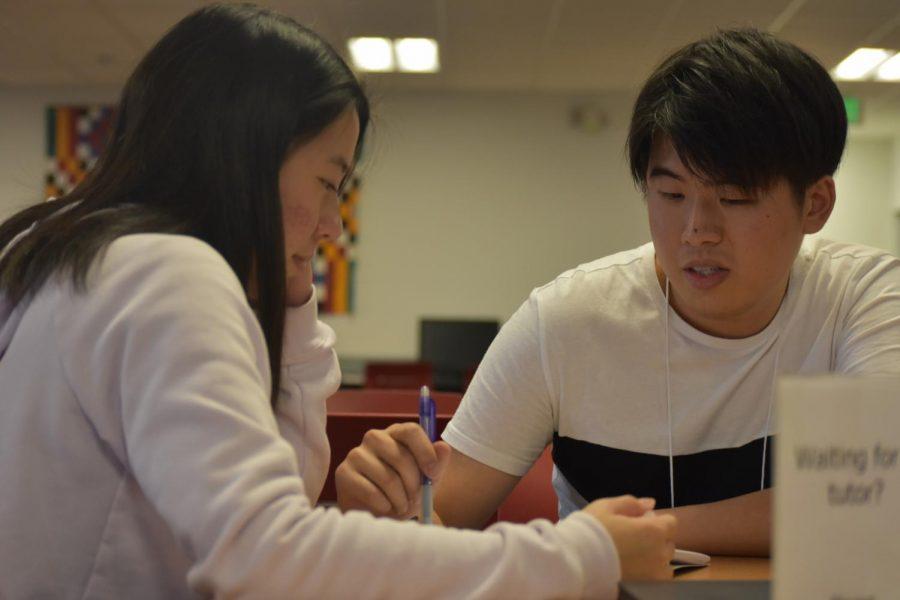 Edmund Ng, 24, environmental science major tutors Kelly Chau, 19, psychology major at the Writing and Reading Center on Thursday, Nov. 29