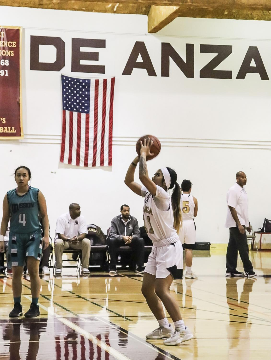 Number+11+guard+Doryn+Gomez+makes+a+free+throw+at+the+line+during+a+home+game+on+Jan.+11.