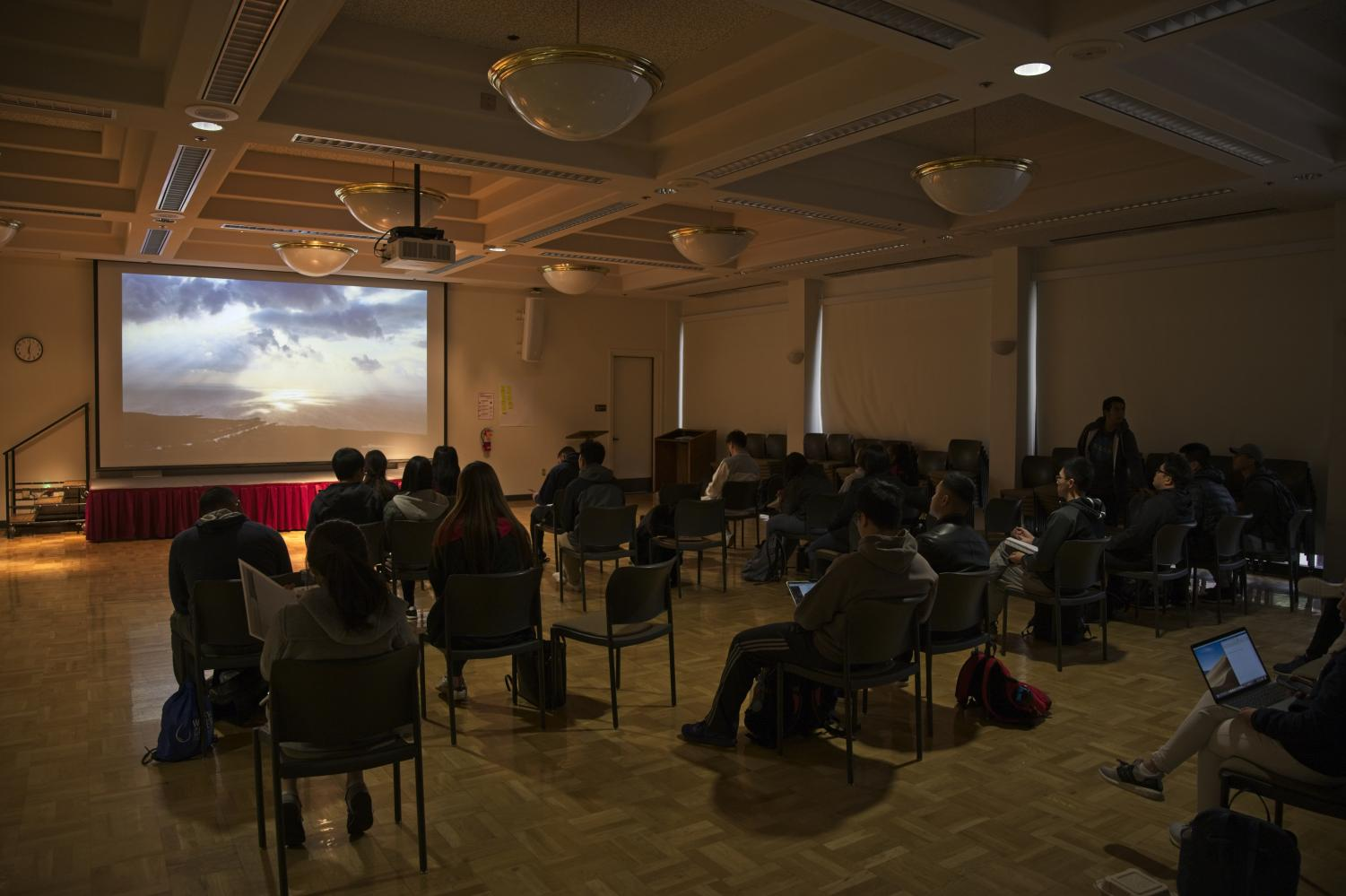 Students view a screening of