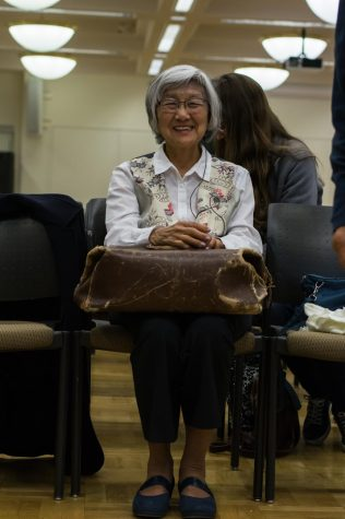 Amy Iwasaki Mass holding one of the 50 objects, the 'Bag by the door' at the Day of Remembrance event on Feb. 19.