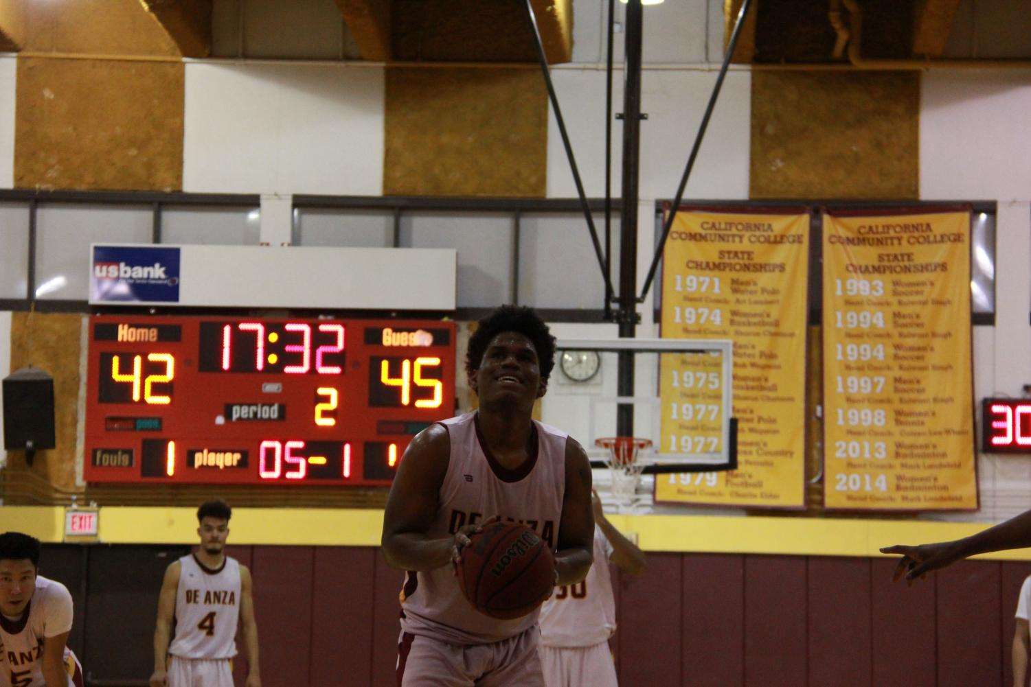 Guard Darien Davis, 20, communications major prepares to make a free throw at the line during a home game on Feb. 13.