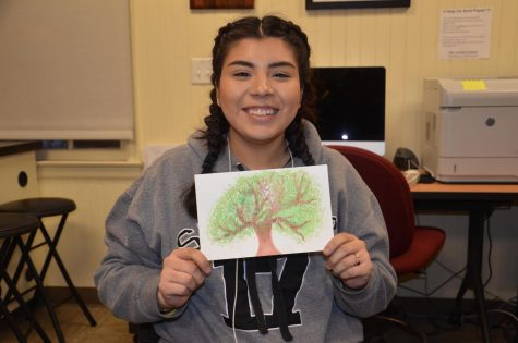 Jocelyn Lopez, 19, criminal justice major, with a paining shat made during the self-care event on Feb. 14.