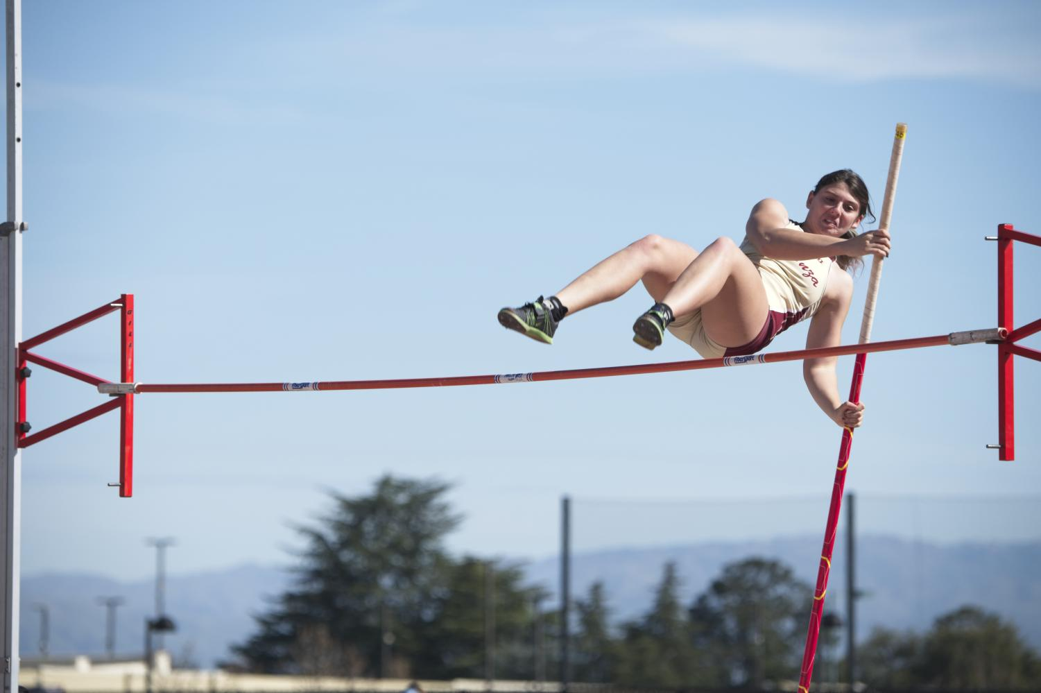 Melissa Favorite, 19, political science major competes in the pole vault at the De Anza Open on Feb. 23.