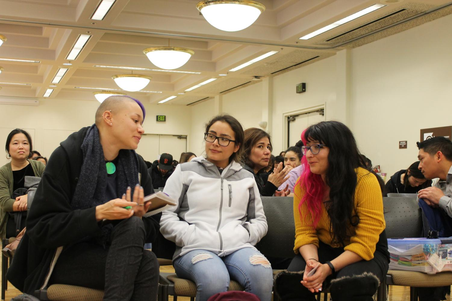 [Left to Right]  Students Gabrielle Paiso, 21, psychology major, Paulina Ochaa, 21,  ethnic studies major and Brenda Carillo, 23, psychology major,  discussing on the film that was screened.