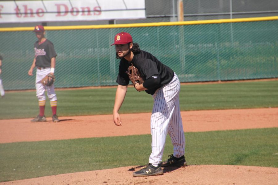 Antonio Triest Escobar, 19, communications major, looks for the right pitch against San Mateo in a home game on March 12.