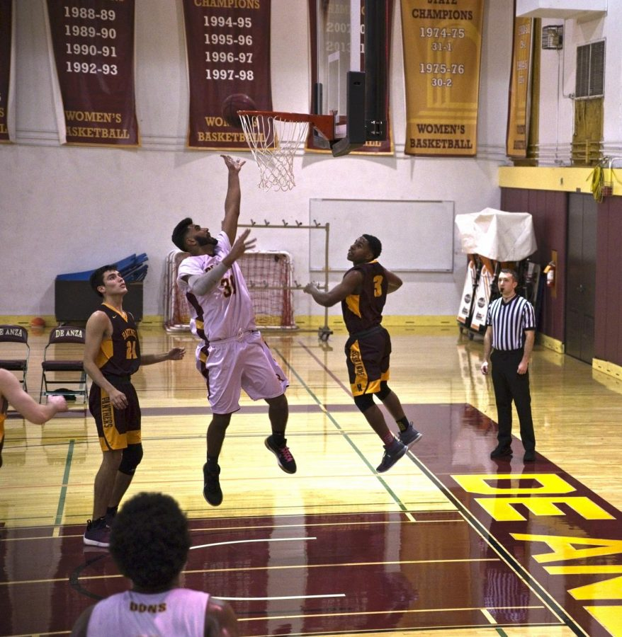Sophomore wing Ajay Singh attempts a layup during the Feb. 22 game against Hartnell College.