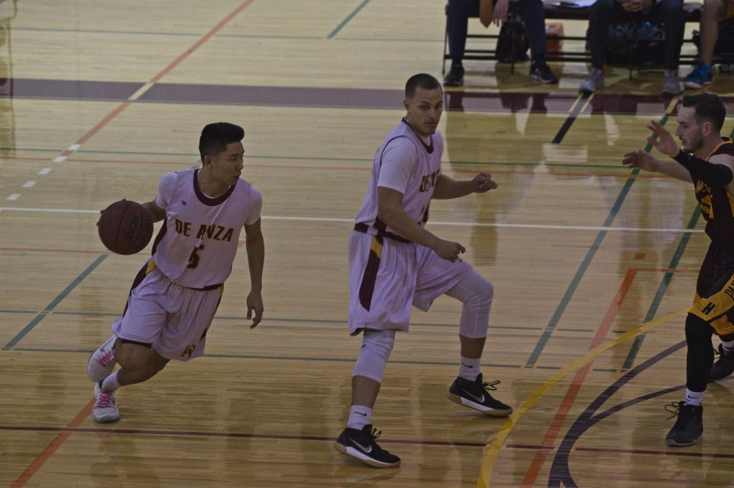 Sophomore guard Blake Uyehara dribbles past sophomore guard Austin Yvanovich during the Feb. 22 game against Hartnell.