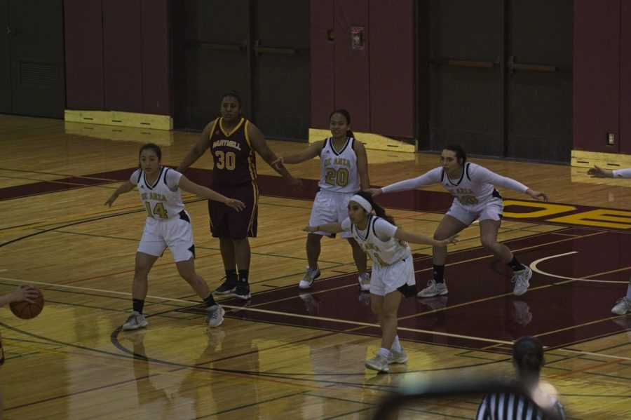 Freshman forward/guard Hannah Lee, freshman guard Valerie Batino, sophomore guard/forward Sophia Rodriguez, and sophomore guard Doryn Gomez assume defensive positions during the Feb. 22 game against Hartnell.