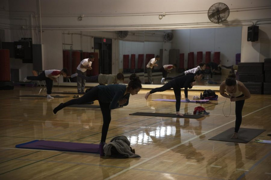 Flow Yoga course instructor Danielle Altman leads students in poses on March 12.