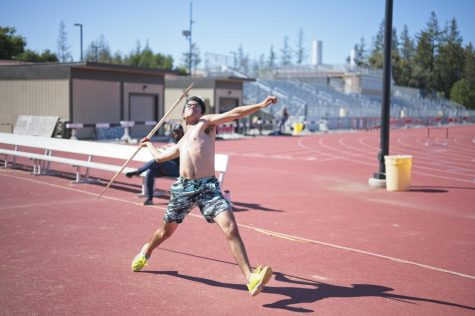 Mid-distance runner and javelin thrower Emilio Zertuche, 19, film and television production major practices the javelin at the De Anza track on April 22.
