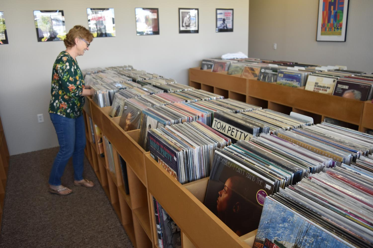 Kate Hartsell, co-owner of The Analog Room, sorts through vinyl LPs.