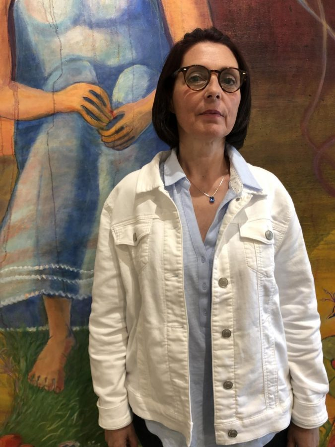 Marie Serda, 57, art major, has her painting