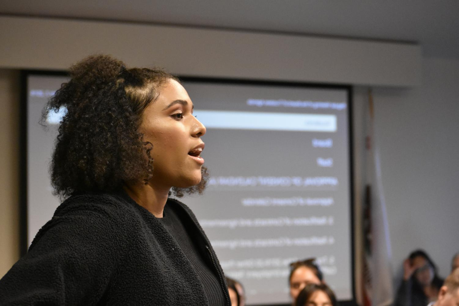 DASB Vice President Maya Burns spoke in favor of affordable student housing in the on-campus Flint Center at the Oct. 7 Foothill-De Anza Board of Trustees meeting.