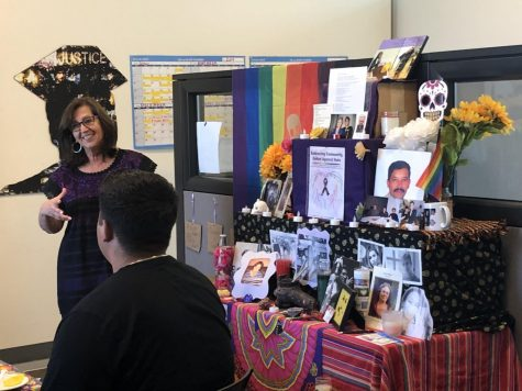 Students, faculty share stories of loved ones around Dia De Los Muertos altar
