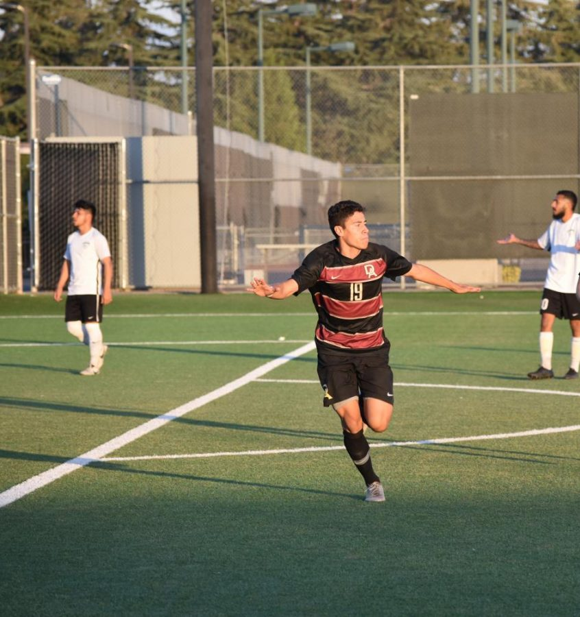 Andres Garcia, 20, criminal justice major, celebrates after a go-ahead goal against Evergreen at De Anza College on Nov. 5.