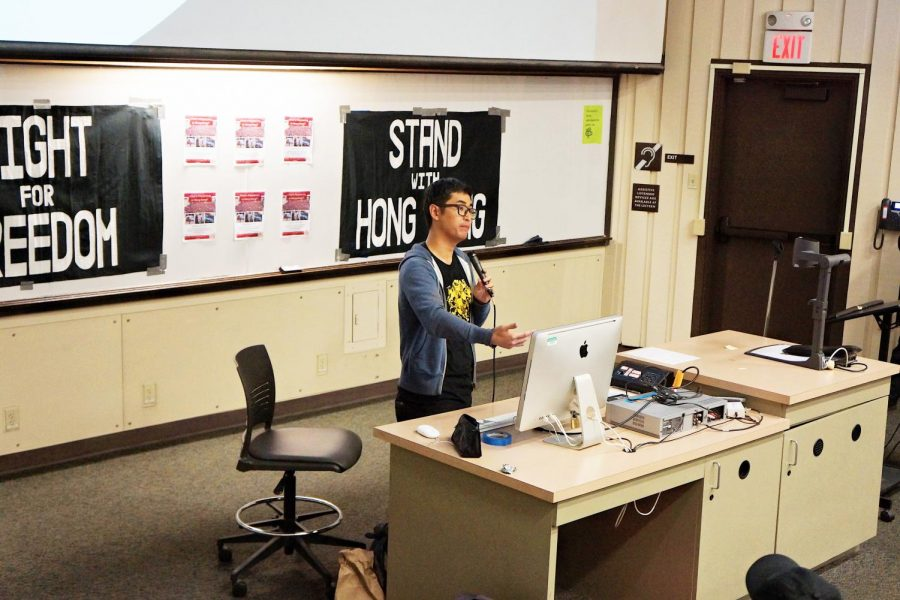 Alex Chow Yong-kang, vice president of the Hong Kong University Students' Union, explains the Hong Kong protesters' five demands on Nov. 21 at De Anza College