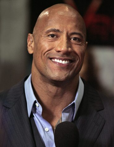 "Dwayne ""The Rock"" Johnson <br> <a href=""https://commons.wikimedia.org/wiki/File:Dwayne_Johnson_2,_2013.jpg"" title=""via Wikimedia Commons"">Eva Rinaldi</a> [<a href=""https://creativecommons.org/licenses/by-sa/2.0"">CC BY-SA</a>]"