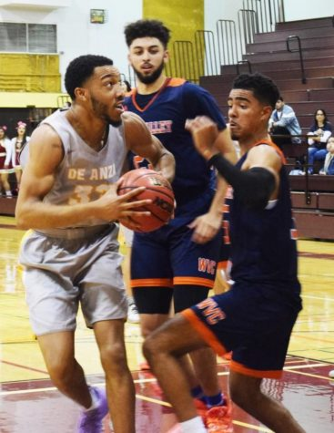 Kyle Nelson, 21, accounting major drives to the basket against West Valley College defenders in a 60-54 home loss Jan. 24.
