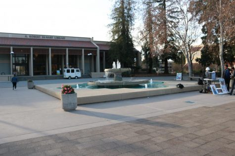 De Anza students nap, talk, eat lunch, and meet up around the fountain located in front of A. Robert Dehart Library.