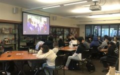 Students watch presentation on the Malayan Movement.