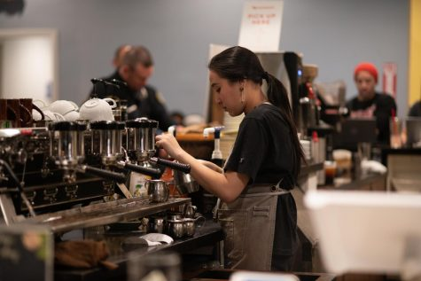 Samantha Tran, 21, biology major prepares a customer's order at Big Mug Coffee Roaster.