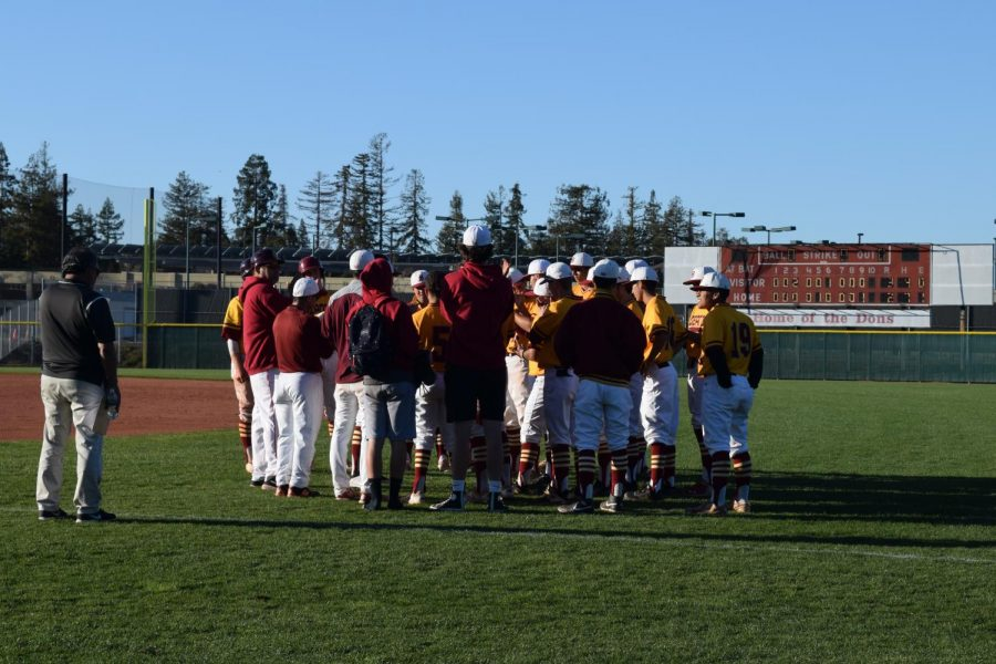 De Anza's baseball team gather around after a close game.