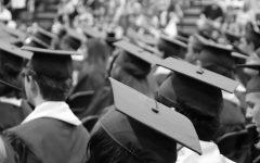 Students sitting in graduation attire