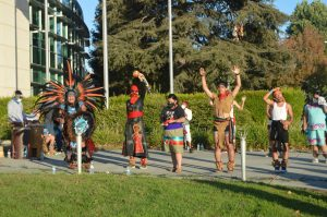Indigenous people perform dances, play drums and give speeches