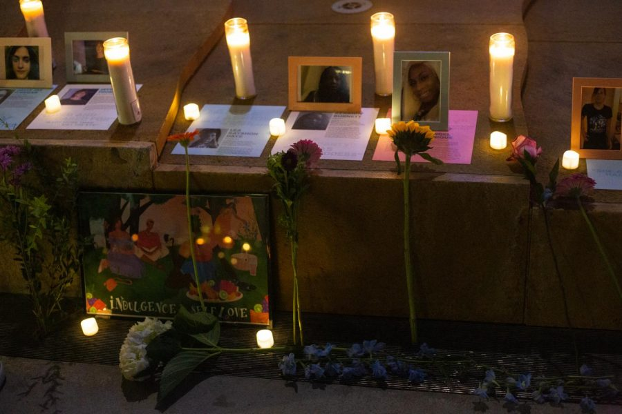 At the vigil, photographs of transgender victims, their description, and artworks line the steps at San Jose City Hall.