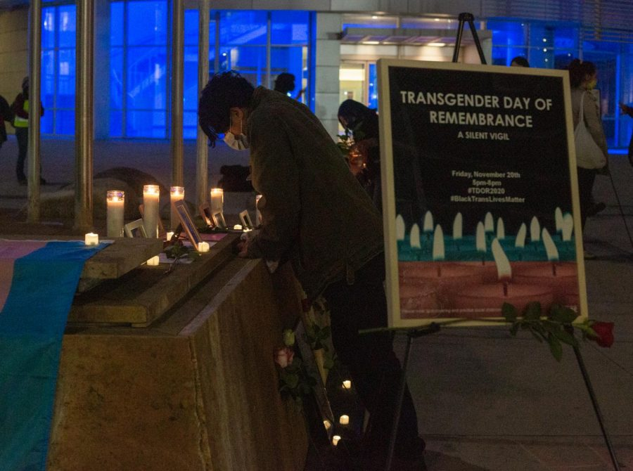 People at the Transgender Day of Remembrance vigil at San Jose City Hall  mourn the deceased transgender victims.