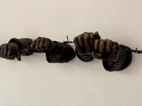 "A photo of the bronze sculpture ""If the Leader Only Knew"" from ""Punctum"" series by Hank Willis Thomas, depicting hands grasping barbed wire."